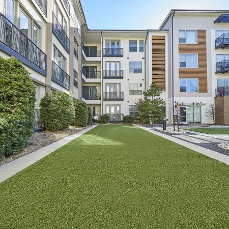 BEAUTIFUL COURTYARD SURROUNDED BY APARTMENTS AND LANDSCAPING