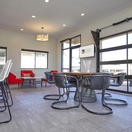 LUXURIOUS LEASING LOUNGE WITH KITCHEN AND SEATING AREAS.
