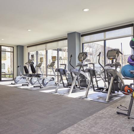 24/7 BI-LEVEL PREMIER FITNESS CENTER, WITH STRENGTH TRAINING AND CARDIO EQUIPMENT.