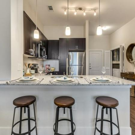 Beautiful Kitchen with Granite Countertops and Kitchen Island