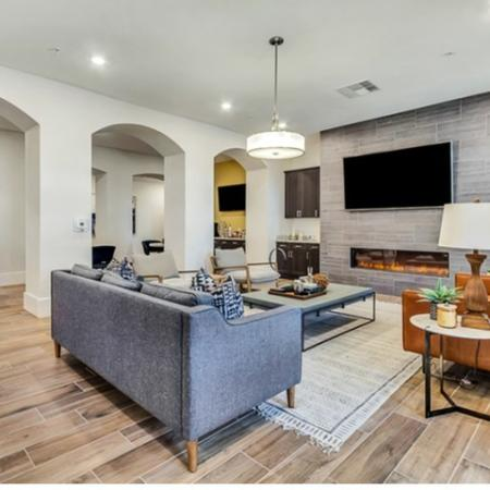 Resident Lounge with Seating Area, Indoor Fire Pit, and Television