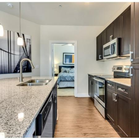 Spacious Kitchen wtih Custom Wood Cabinetry, Pantry Space, and Stainless Steel Appliances