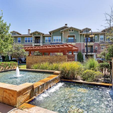 Outdoor fountains right next to the resort inspired swimming pool. Mustang Park Apartments, Apartments in Carrollton, Apartments for Rent in Carrollton Texas, Luxury Apartments Carrollton