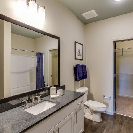 Bathroom with white cabinetry and granite countertops