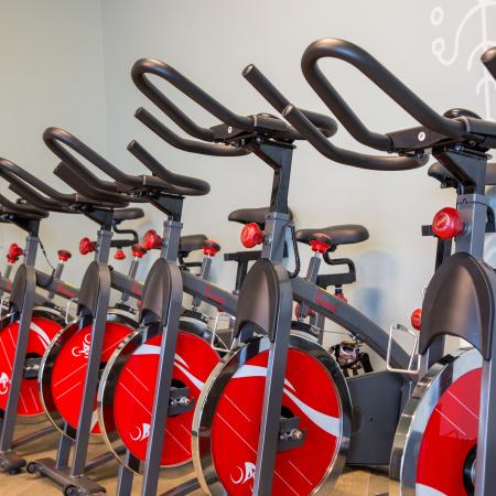 A row of spin bikes in the state of the art gym