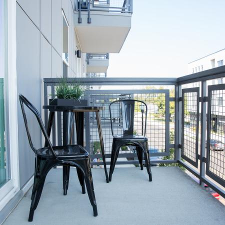 Balcony off of the unit with modern outdoor furniture