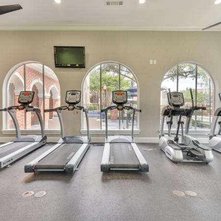 Fitness center open 24/7 and TV screen