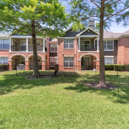 Beautiful brick apartment homes with private fenced yards in select apartment homes