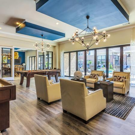 Open, flowing club room with lounge seating, TV's and gaming area