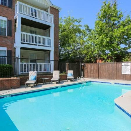 Beautiful renovated enclosed swimming pool with sun deck and cushioned lounge chairs