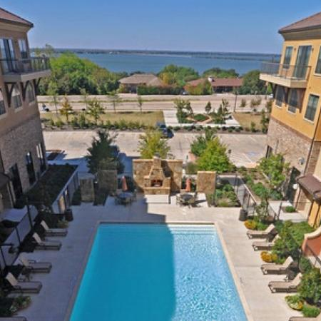 Year Round Swimming Pool. Heated pool with outdoor lounge, fireplace, and great views of the lake | Apartments in Rockwall TX | Rockwall Commons