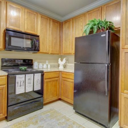 Pine cabinets with black appliance package | Apartments for rent | Houston, Tx 77043