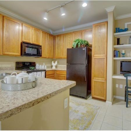 Full black appliance package includes dishwasher, microwave, refrigerator and stove. Also, included is a built- in desk and tile flooring | Apartments for rent | Houston, Texas