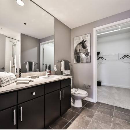 Spacious master bathroom with ceramic tile flooring