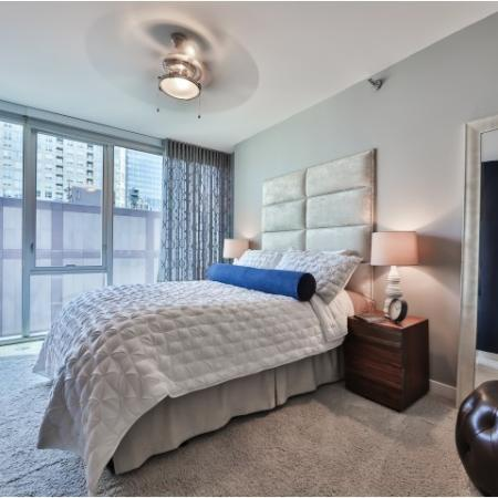 Spacious, fully furnished master bedroom with walk-in closet