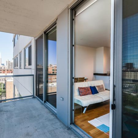 Private balcony with floor-to-ceiling windows and a city view