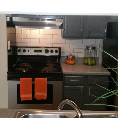 Contemporary Grey cabinets with subway tile in kitchens