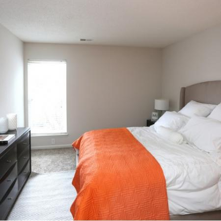 Large Master Bedroom that fits a Queen / King bed, along with Dresser and Lounge Chair.