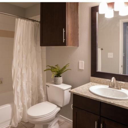 Bathroom with Granite Countertop Vanity and Garden Soaking Tub
