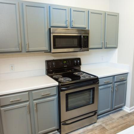 Kitchen with modern grey cabinetry and lighting