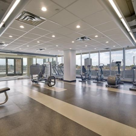 Fitness Center with cardio equipment and large windows