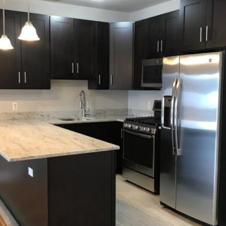 Sleek granite countertops, tile floors and gleaming stainless steel appliances.