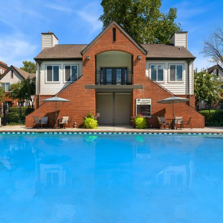 Sparkling pool with view of 2 story clubhouse