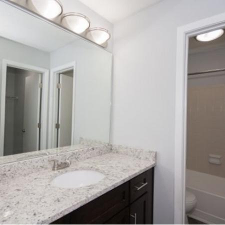 Bathroom with white granite countertops