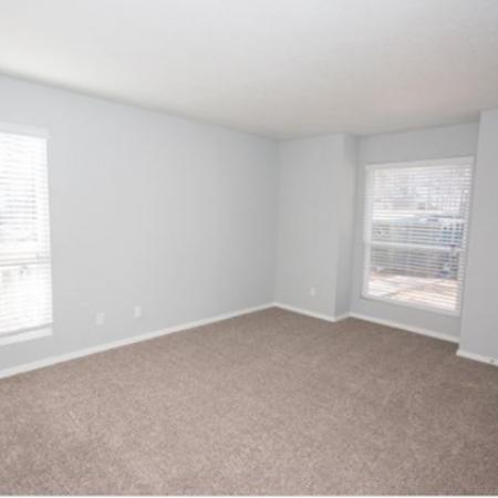 carpeted bedroom with grey walls and white trim
