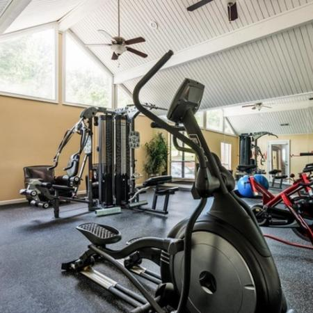 fitness center of elliptical, rower, treadmill and universal weight machine