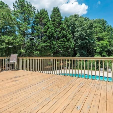 sundeck overlooking the pool surrounded by trees