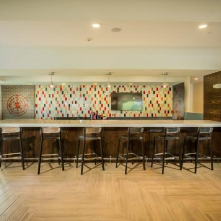 shared community kitchen lounge with bar table and seating