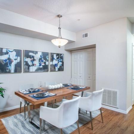 Alvista Metrowest Orlando Florida dining room with overhead pendant light with double folding door closet an entry adjacent