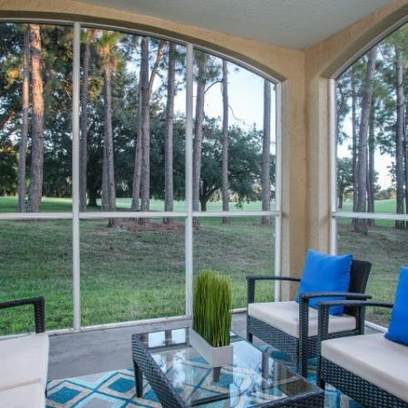 Alvista Metrowest Orlando Florida screened in porch with wooded golf course view