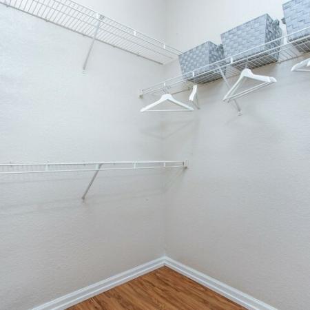 Alvista Metrowest Orlando Florida walk in closet with vinyl plank flooring and wire shelving
