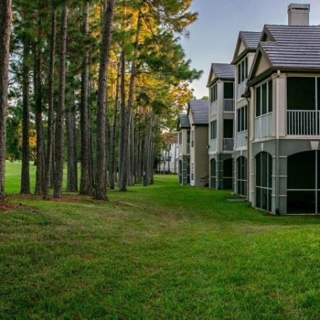 Alvista Metrowest Orlando Florida exterior of buildings with screened patios overlooking a wooded lawn