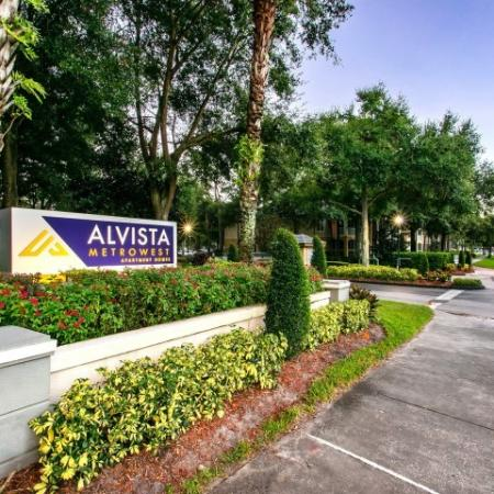 Alvista Metrowest Orlando Florida front entry with monument sign with logo, lush landscaping and sidewalk