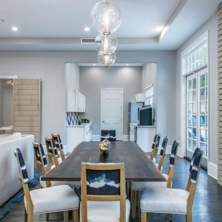 Alvista Metrowest Orlando Florida clubhouse dining table and chairs with adjacent kitchen area