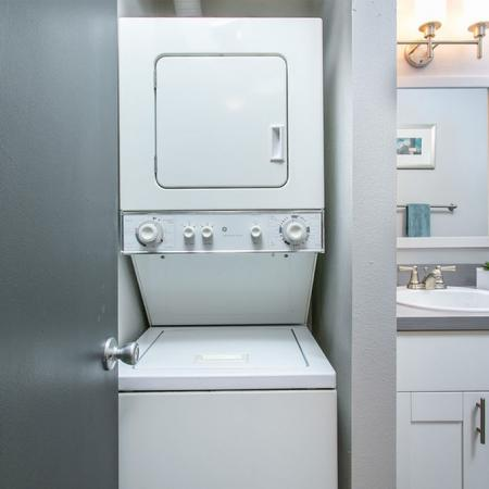 Washer dryer unit by the bathroom