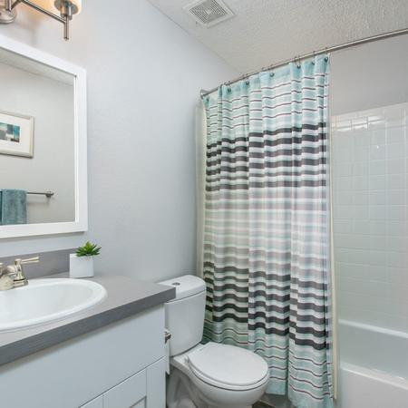 Bathroom with white cabinetry and light grey countertops