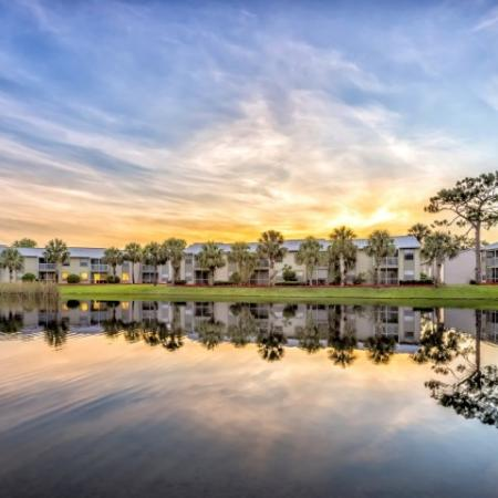 Alvista Golden Gate community view from pond with sunset over buildings