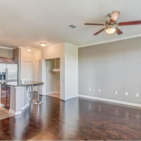 Hardwood floors, private balconies, TownHome Living, W/D Connections.