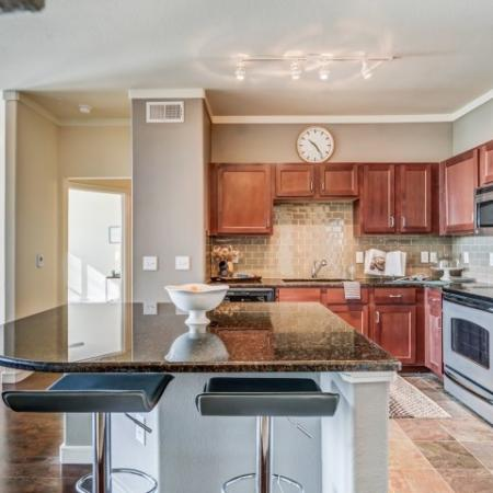 Kitchen, back splash, side by side refrigerators, tile slate entries, town home living.