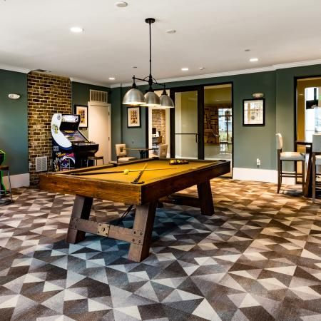 Resident game room with pool table and arcade games