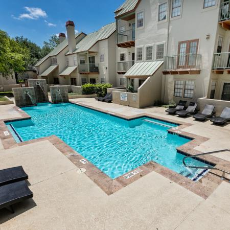 2nd Pool with water feature and poolside loungers