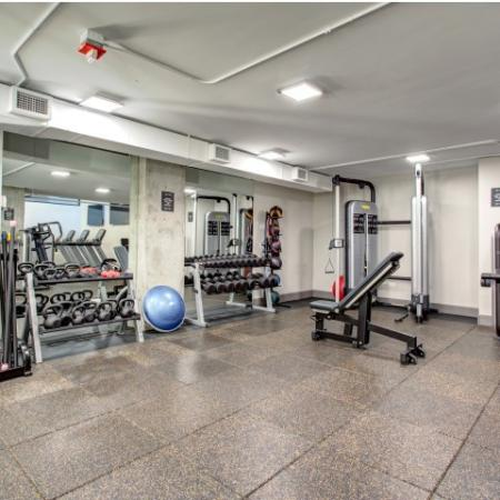 Fitness center with free weights and exercise equipment