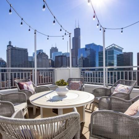 Rooftop entertainment lounge area with skyline city views