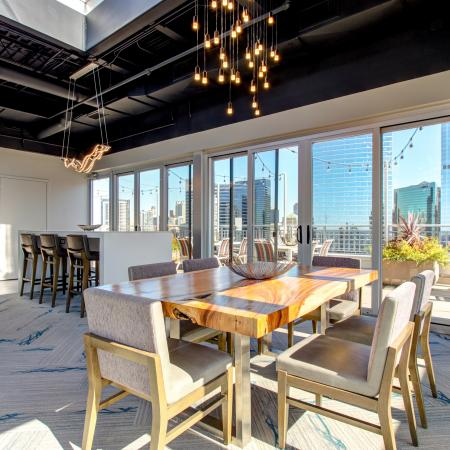 Rooftop club room with wet bar and floor-to-ceiling windows