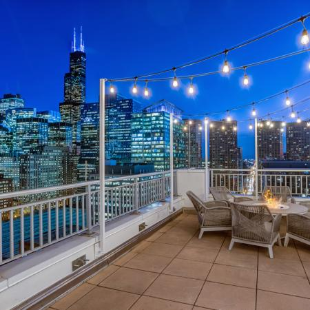 Skyline night time view of Chicago from 180 North Jefferson's rooftop balcony