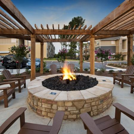 Cozy firepit with adirondack chairs